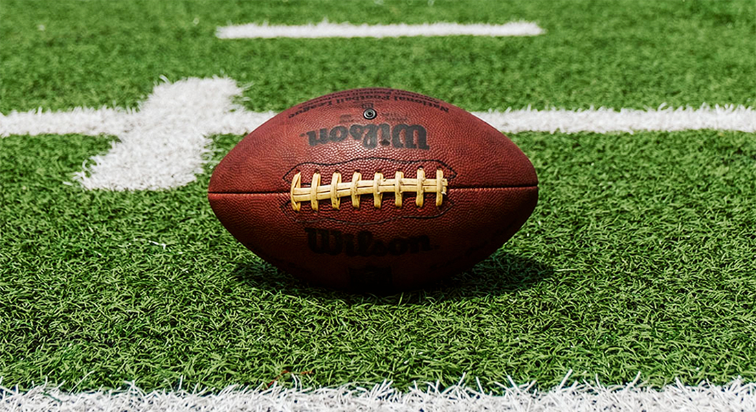 Football sitting on artificial turf