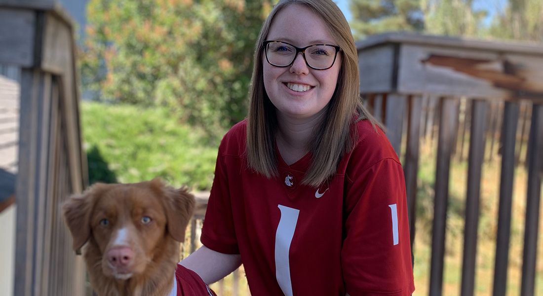 Third-year veterinary student Kady Audette poses with her dog Stark, a Nova Scotia duck tolling retriever.