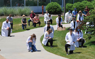 Dr. Jennifer Scaccianoce, a clinical assistant professor at ISU College of Veterinary Medicine, organized a collective kneel in support of White Coats for Black Lives, a national campaign to dismantle racism in medicine. (Photo by Dave Gieseke/ISU)
