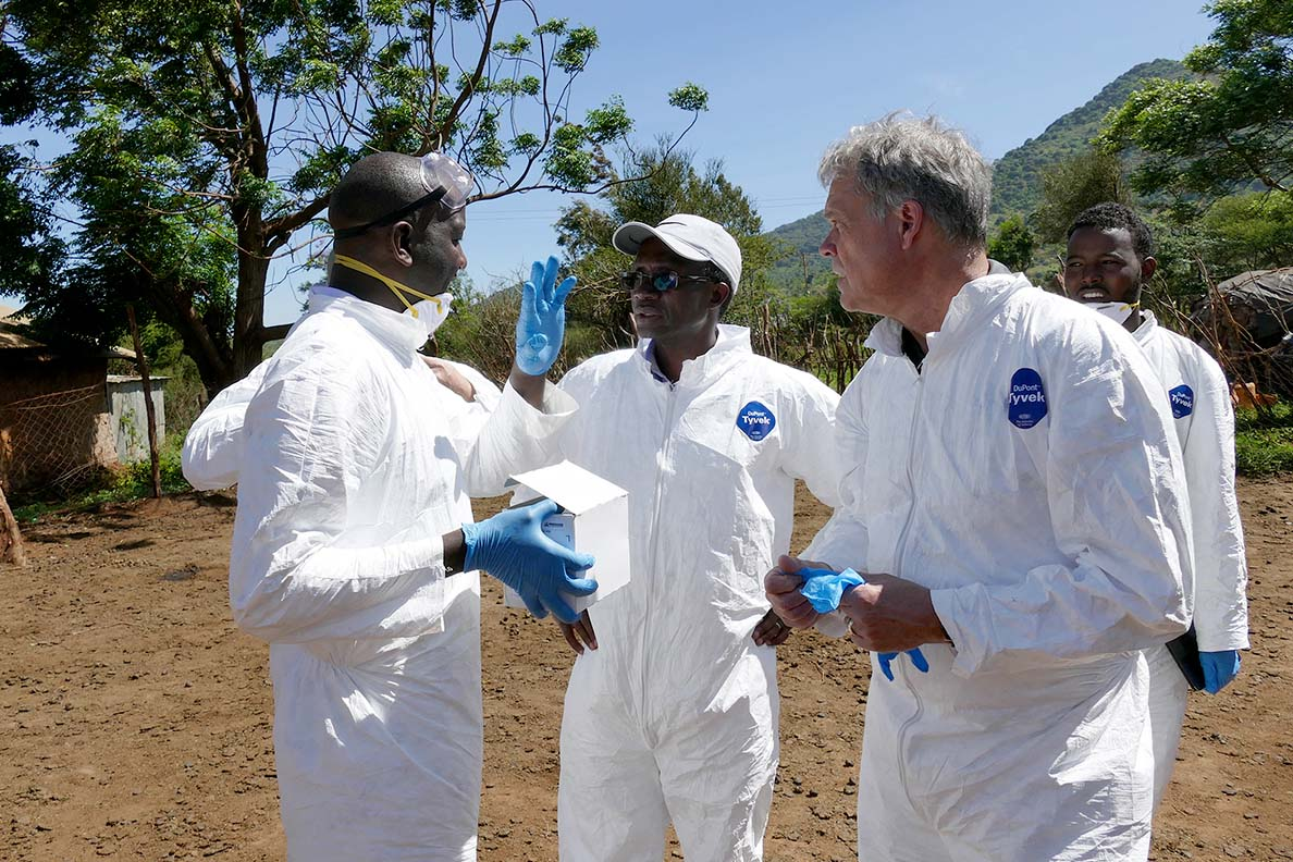 WSU's Kariuki Njenga (center) and Tom Kawula (right) work with colleagues to prepare testing for MERS-COV as part of Paul G. Allen School for Global Health's ongoing international work to detect emerging infectious diseases.